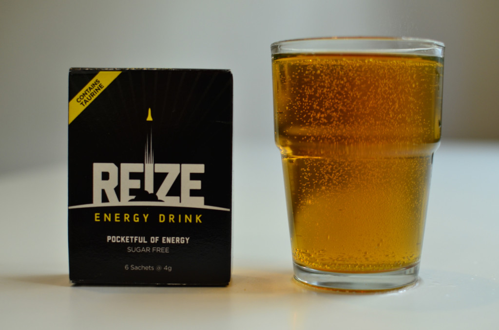 Box of REIZE next to mixed glass