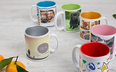 Christmas gift ideas for men and women: Personalised photo mugs featuring images of friends, family and pets. Available from photobox.com.au