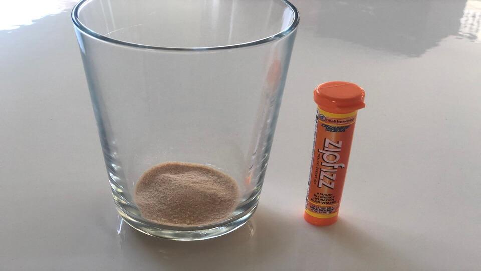 Zipfizz orange soda powder before mixing with water