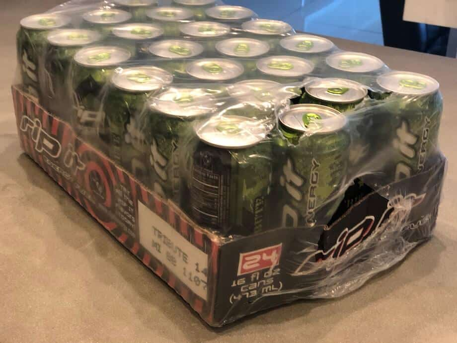 24 green Rip It cans in plastic shipping packaging