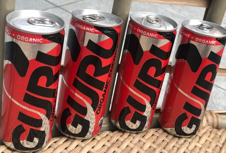 Guru energy drinks in a line