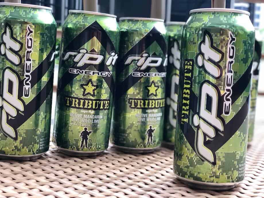 Several cans of Rip It energy drink in a row with one standing out