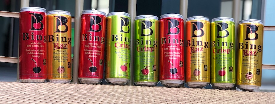 Several cans of Bing energy drink in a row