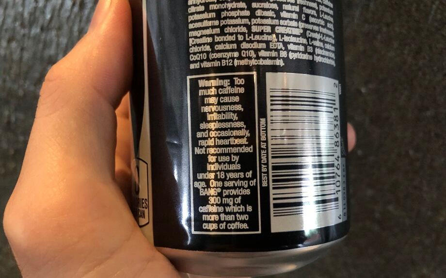 The warning label on the back of Bang energy drink can states the side effects on high caffeine consumption