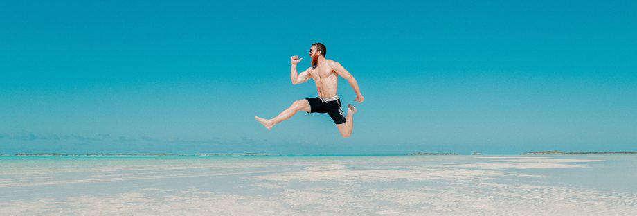 Guy jumping full of energy benefits of energy drink
