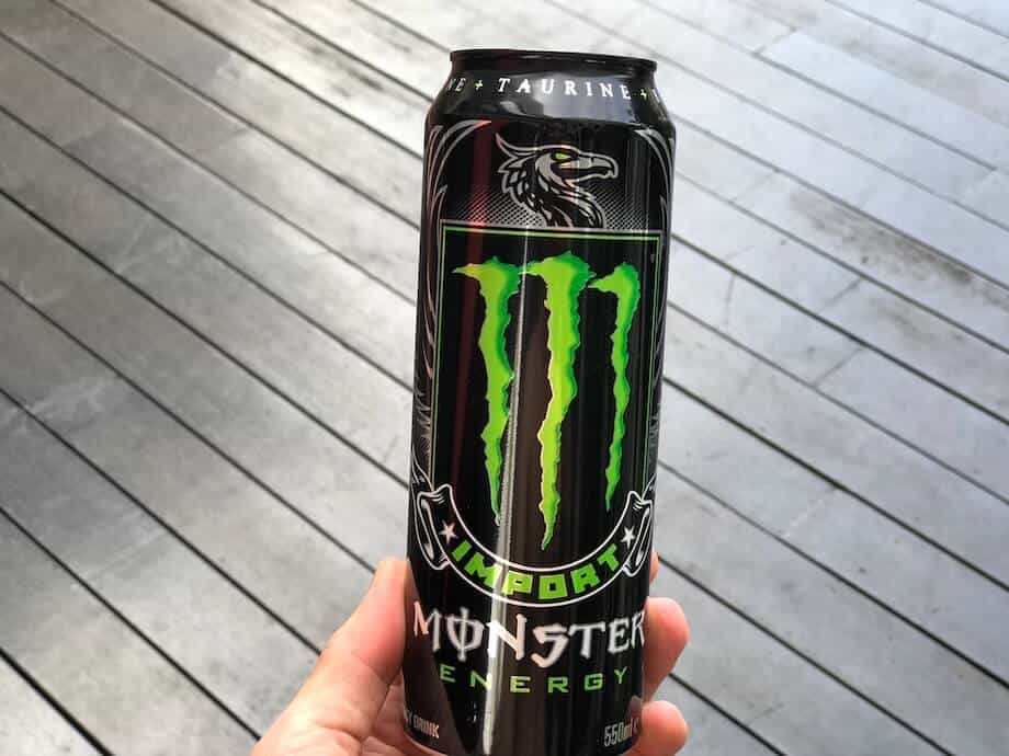 Monster Import single can against wooden floorboards