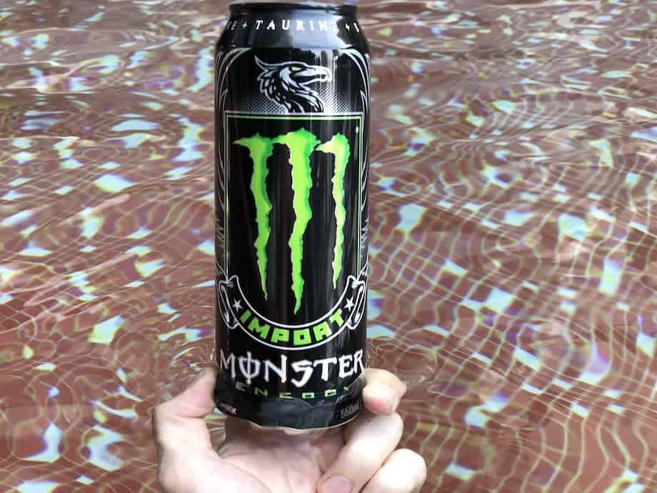 Single monster energy can in water