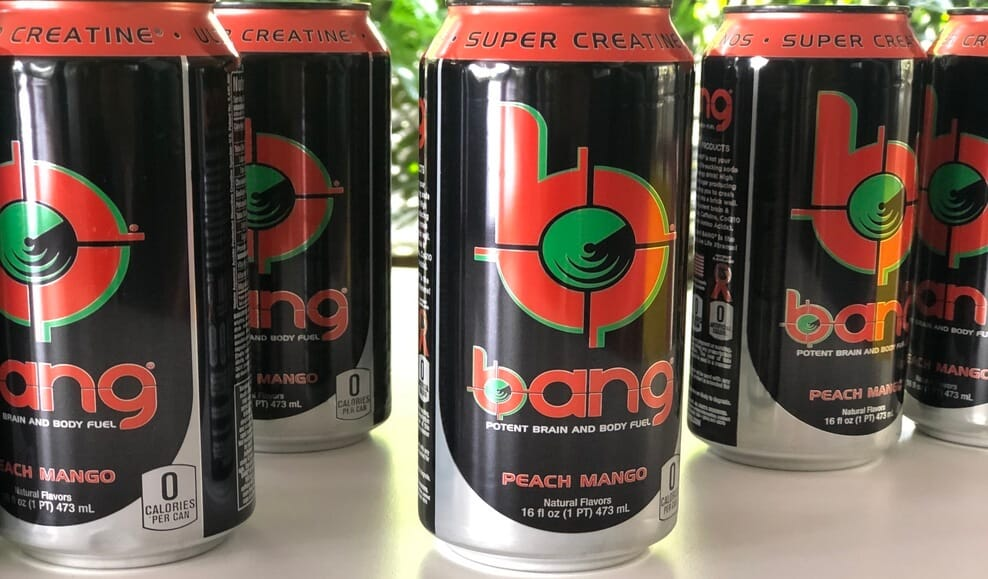 Four Bang energy drink cans on a table