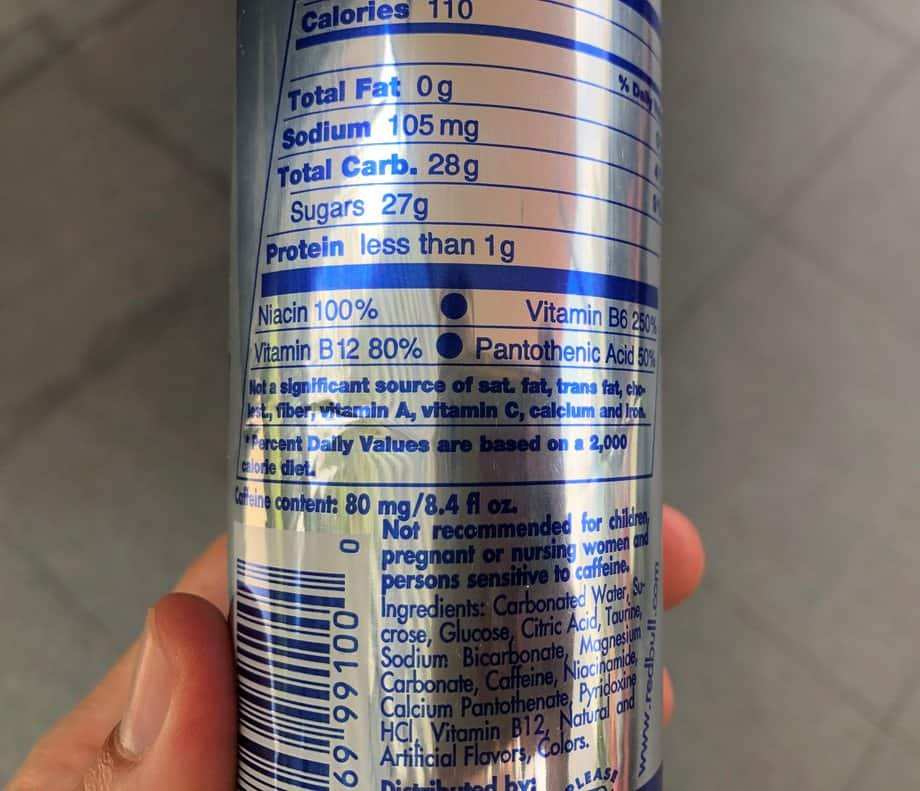Nutrition label at the back of a Red Bull can stating it contains 80mg of caffeine