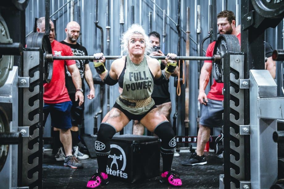 Best workout energy drink Girl squatting heavy weights