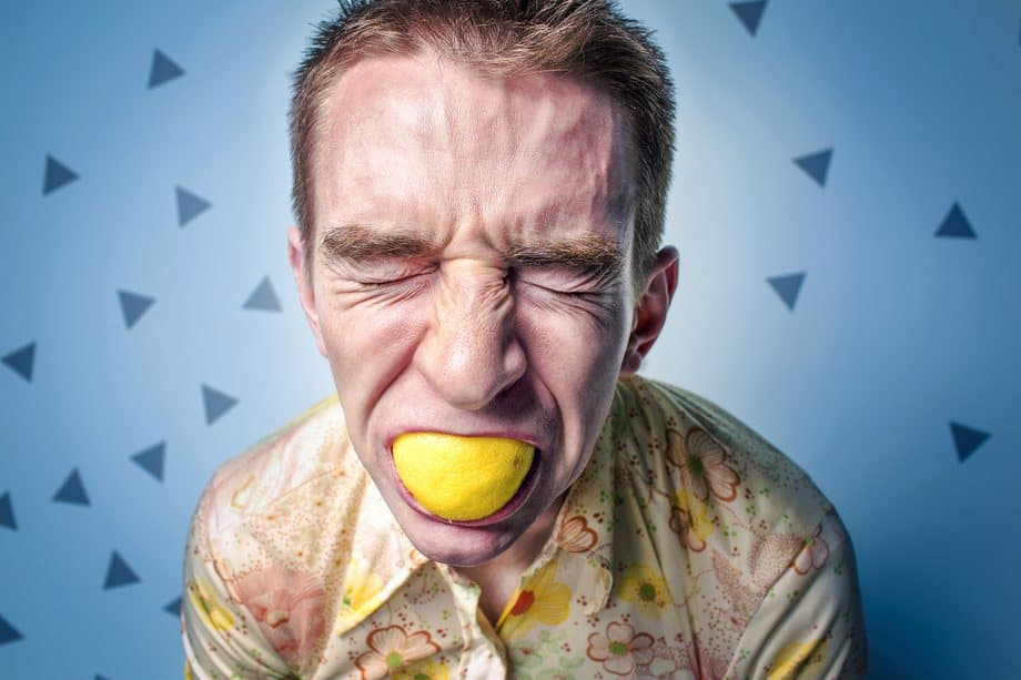 A man chewing on lemon