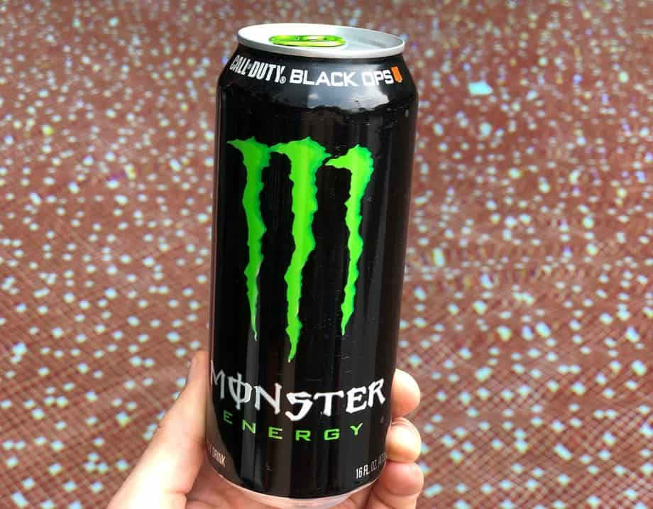 Monster energy best energy drink for driving in front of a swimming pool