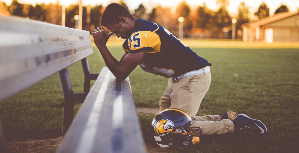 An athlete kneeling