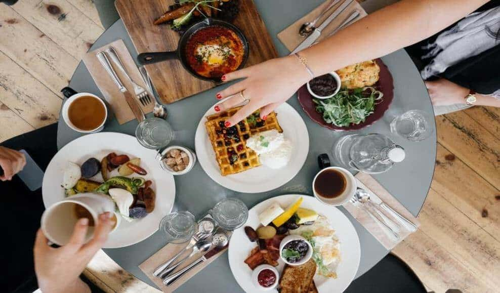 a spread of brunch on the blue table
