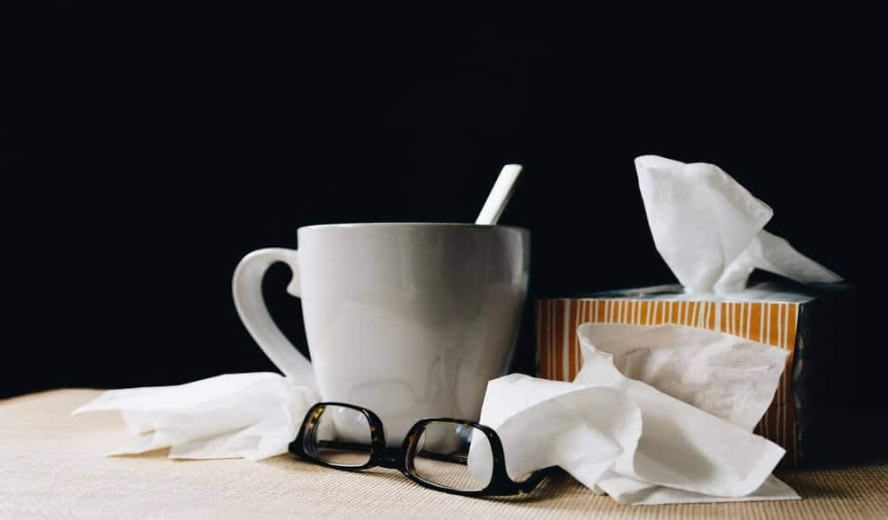 a table with tissues and glasses