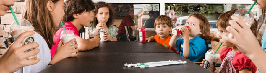 Children drinking Starbucks coffee