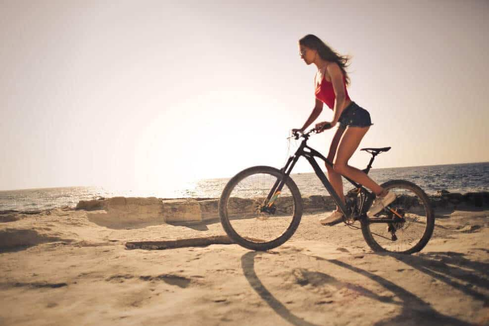 Woman riding a bicycle off road