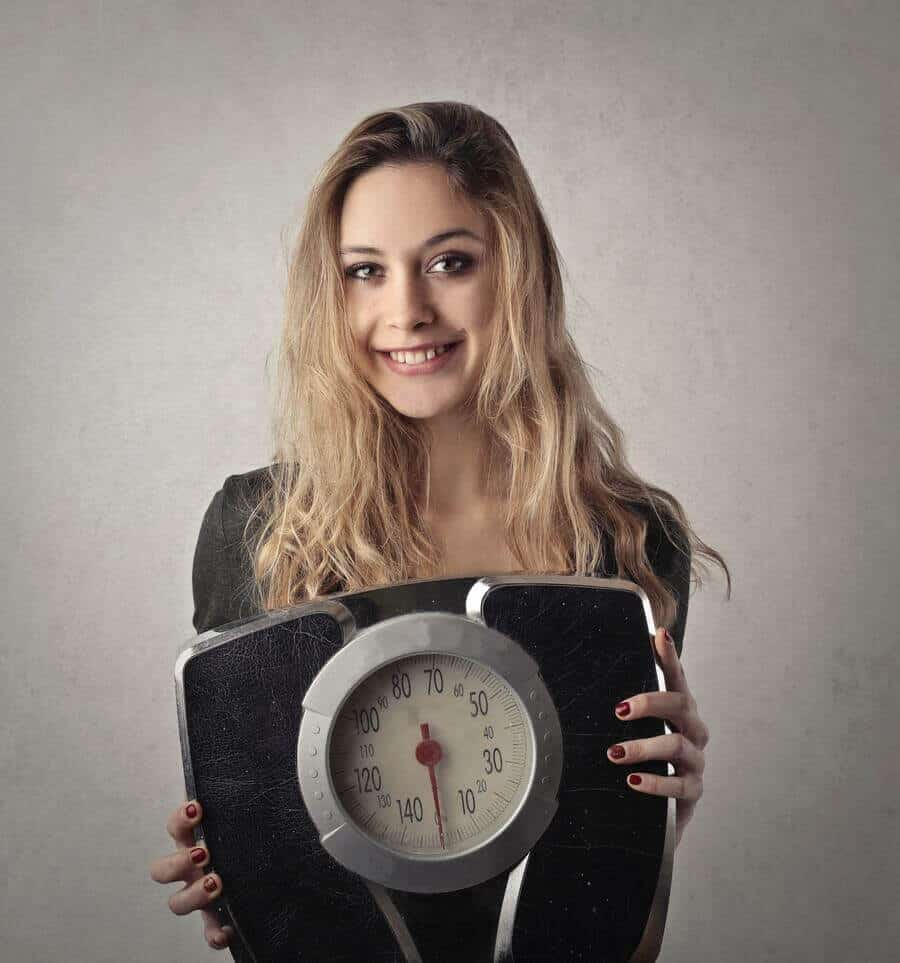 Woman holding a weighing scale