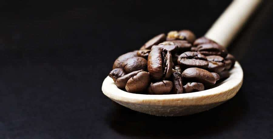A spoonful of coffee beans.