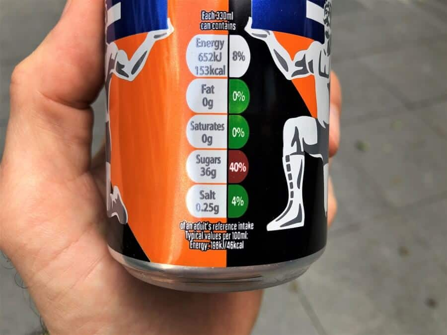 Handheld can of Irn-Bru Energy showing the product's nutrition information.