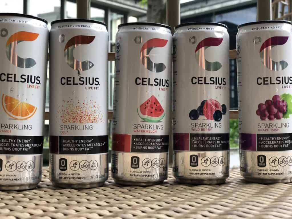 5 different flavoured cans of Celsius energy drinks in a row.