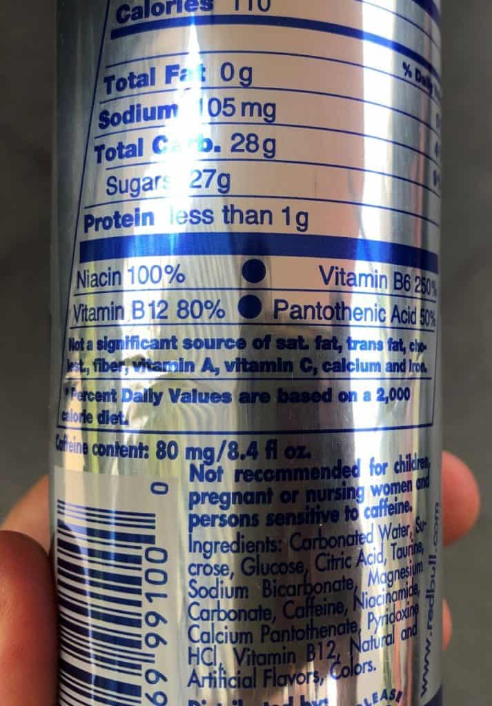 Ingredients and warning labels as seen on a Red Bull can.