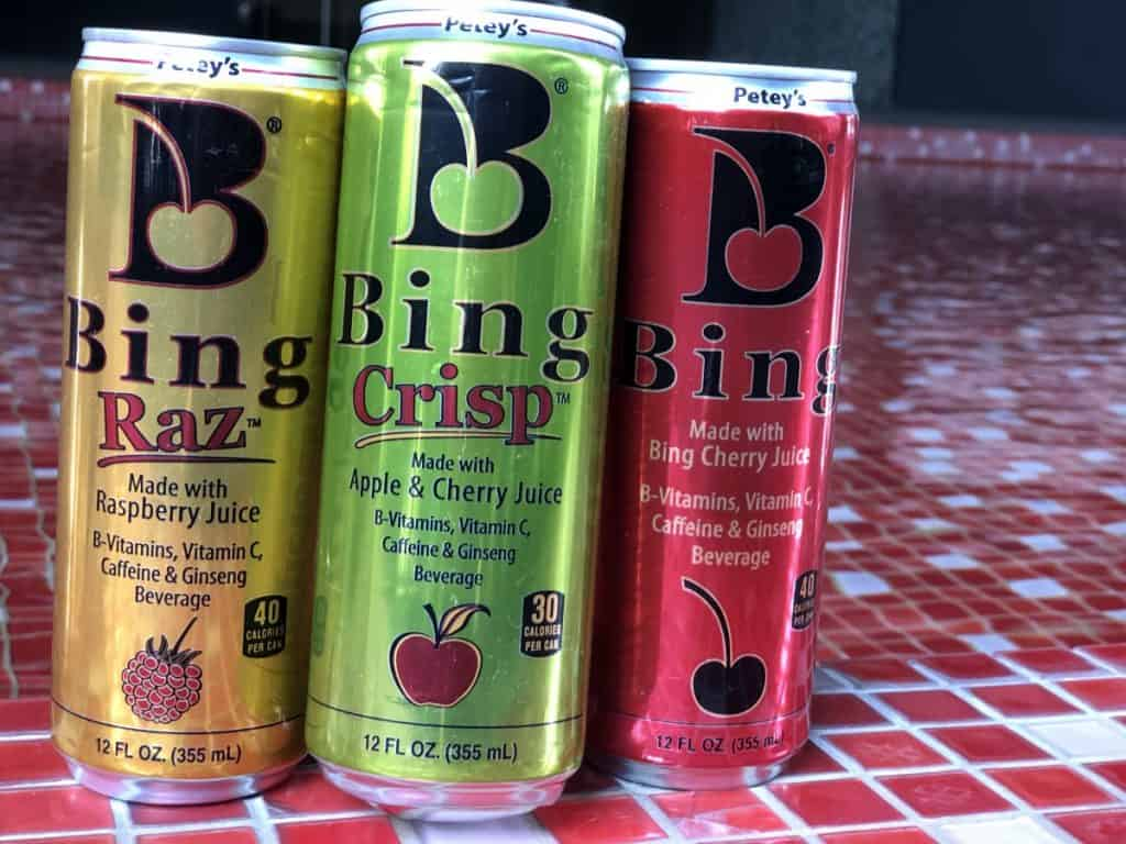 A picture of 3 flavors of Bing energy drinks.