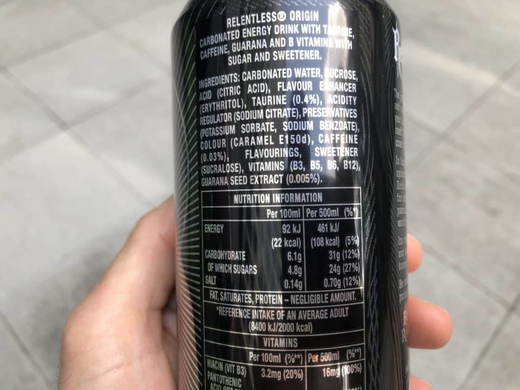 A close-up view of a Relentless energy drink can showing its ingredients and nutrition information.