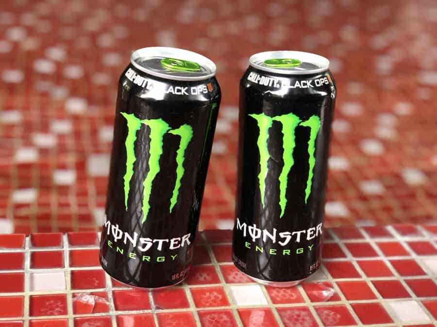 Monster energy drink cans positioned side by side