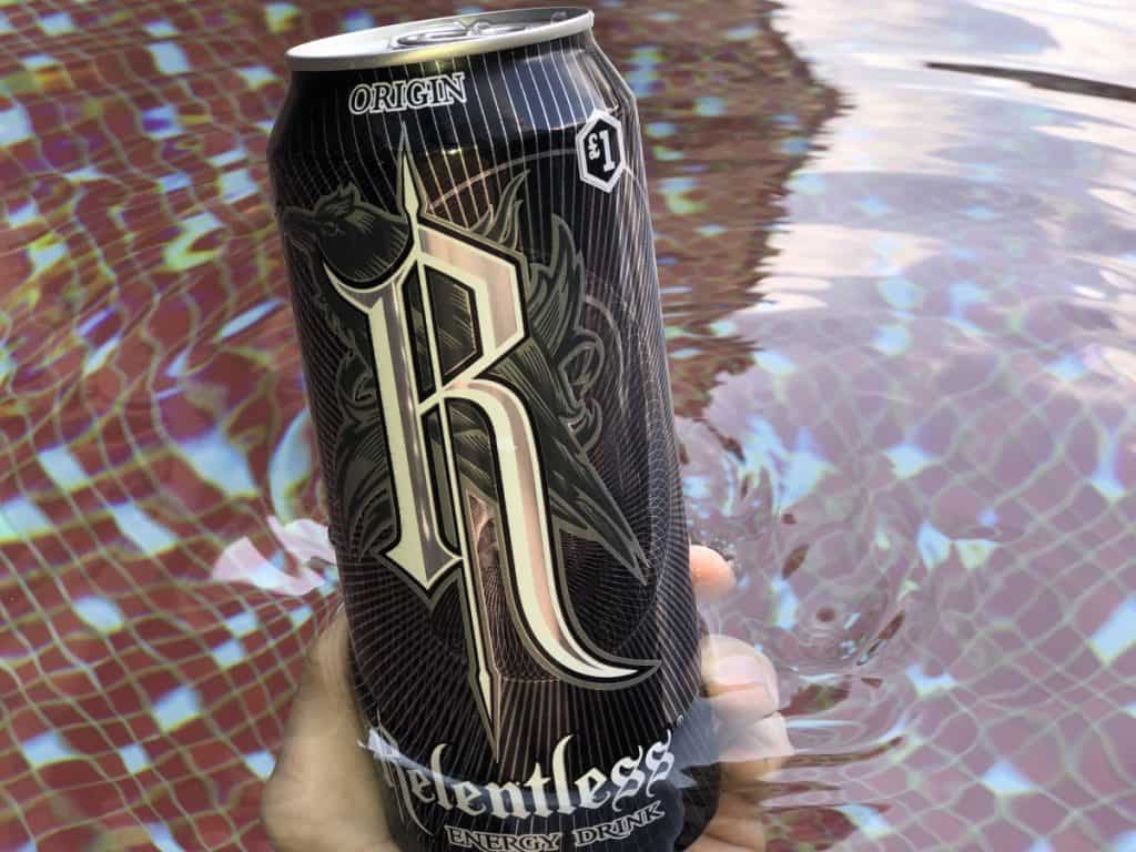A handheld can of Relentless energy drink.