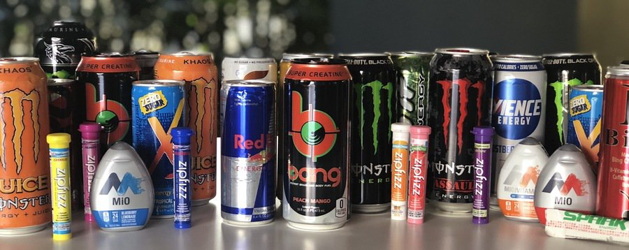 various energy drinks next to each another