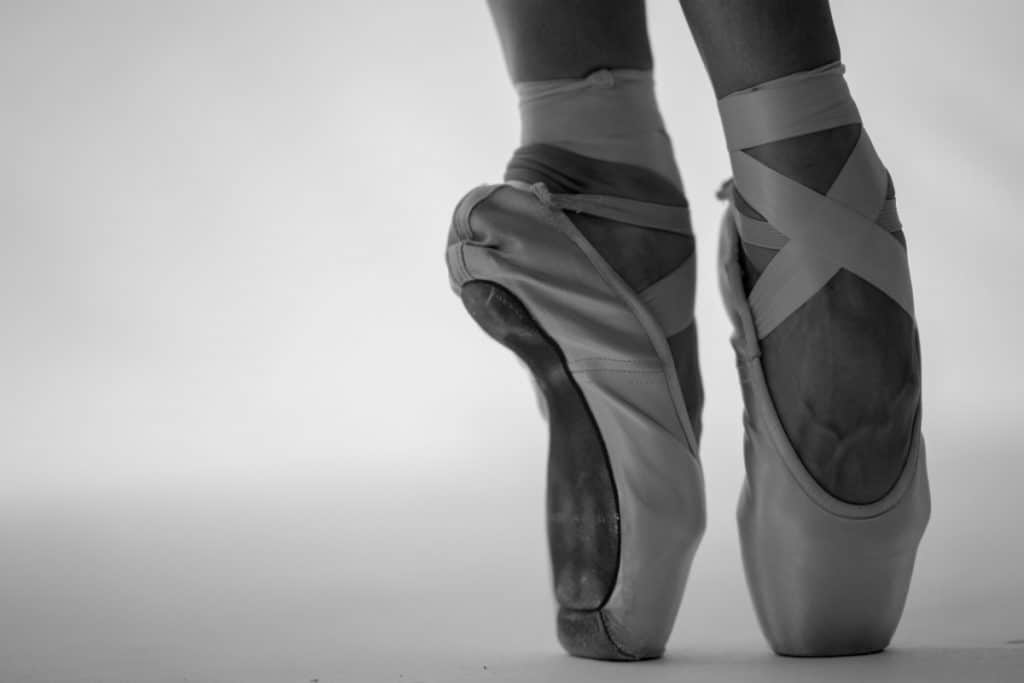 A picture of a pair of pointe shoes.