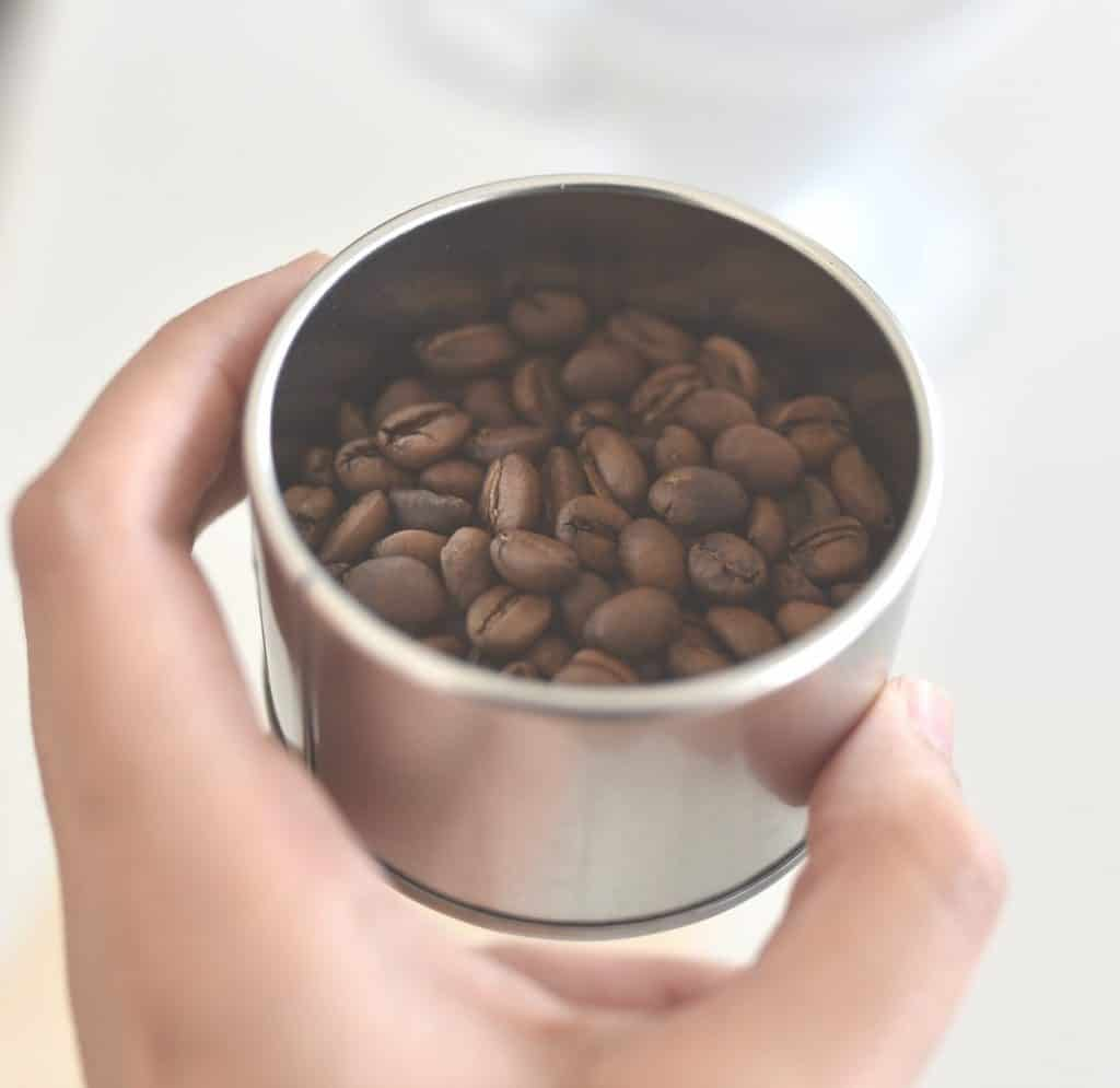 A picture of some coffee beans in a cup.