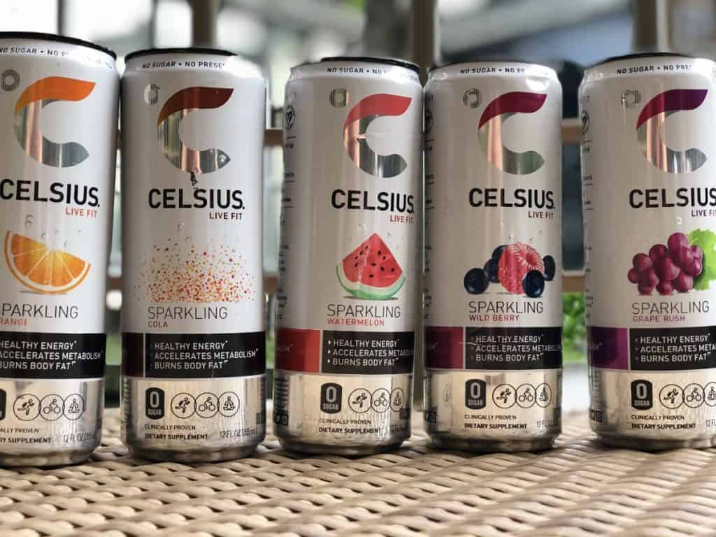 Celsius energy drink cans lined up in a row, each with a different flavor.