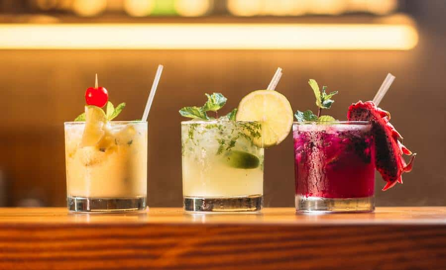 Assortment of fruity cocktails on wooden beam