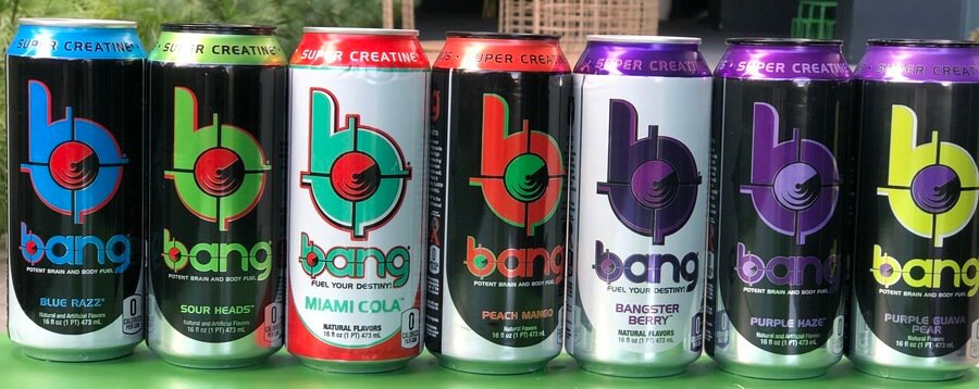 A series of Bang cans lined up side by side on a table.