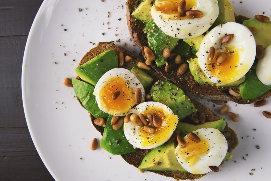 egg and avocado toast on a white plate