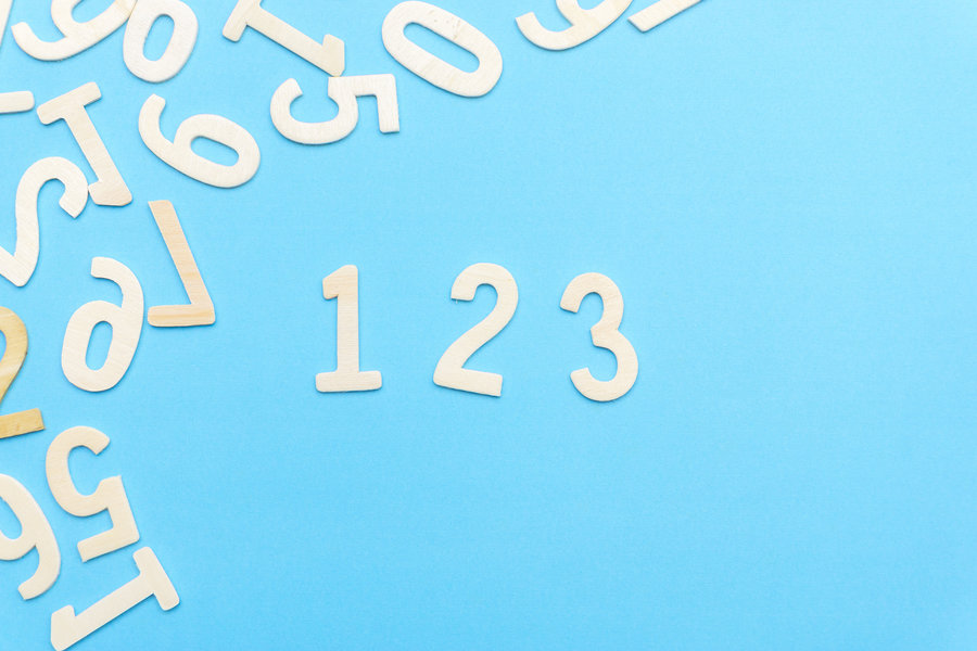 Assortment of numbers with 1, 2 and 3 lined up in the center of the image