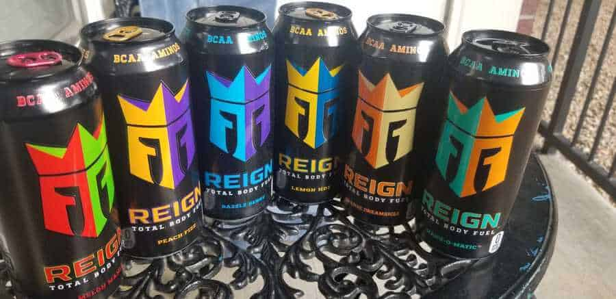 Different flavors of Reign energy drink arranged on the table.