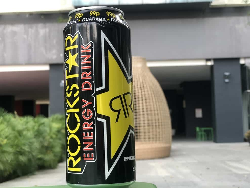 can of rockstar on a bench