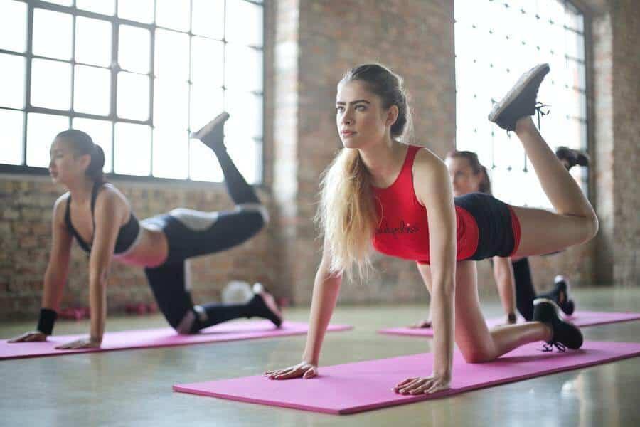 ladies balancing on yoga mat