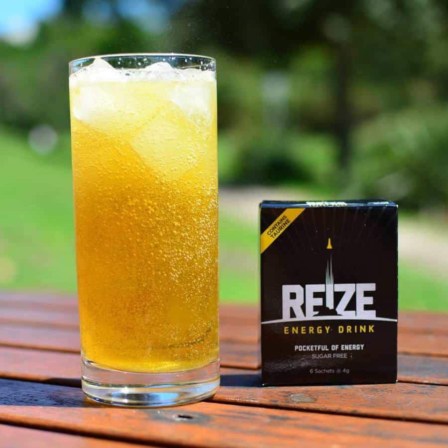 A pack of REIZE and glassful of REIZE energy drink