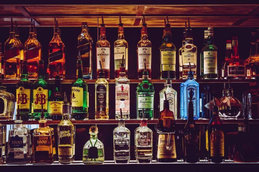 Shelf full of various liquor and spirits.
