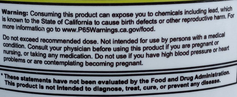 The lead warning label behind a  G Fuel tub.
