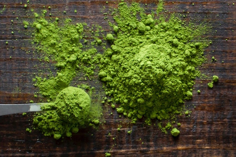 Green tea powder on a wooden table.