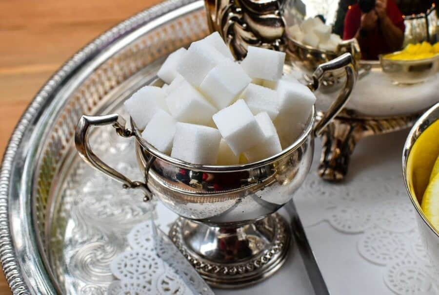 Cubes of sugar in a chalice on a tray.