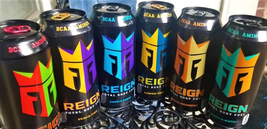 A selection of Reign Energy Drink Flavors in a row.