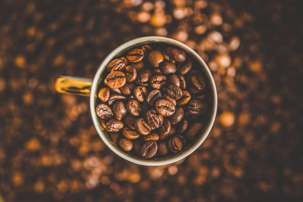 A picture of a mug filled with coffee beans