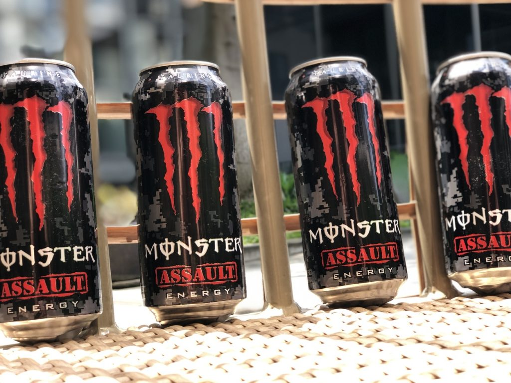 Four cans of Monster Energy Drinks in full view.