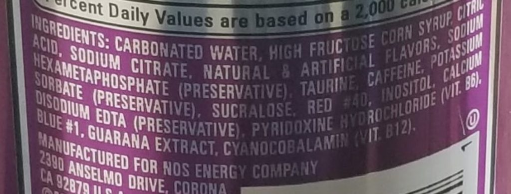 Close-up of the ingredients in NOS Energy.